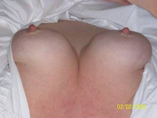 Great tits!  I'd love to kiss, suck and nibble on those boobs...once those nipples are long and hard I'd roll them between my fingers and gently tug on them with my teeth....