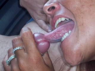 Using my tongue to enjoy this backseat stranger\'s pre-cum.
