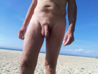 What a great feeling to be out on a HUGE beach completely nude with other nudes around to see me and for me to see.