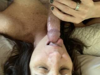 Out of her pussy and into her mouth. Wife licks my tip and tastes her own pussy juices.