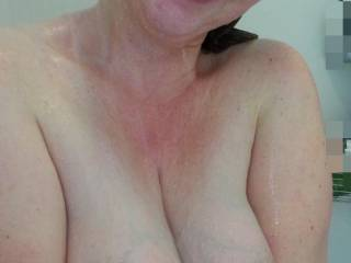 Heavy milk filled tits in the shower... she loves showing them off!