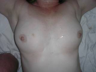 VM's boobs covered in DJ's cum after a night of fun and games.