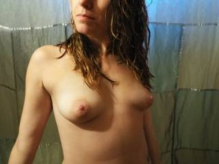Her posing her tiny little tits with face. Close up