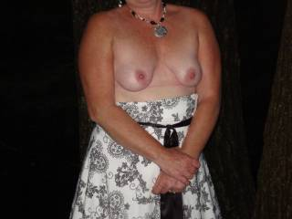 Flashing her tits in Public