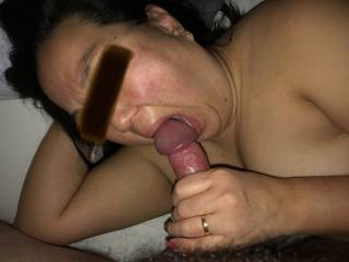 She opens her mouth as much as she can to suck his fat cock