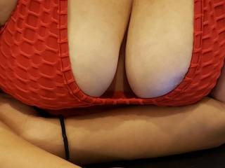 Wearing a red jump suit and teasing me husband and you guys with my boobs.