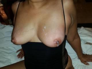 A close up of her cum covered tits...so hot!!