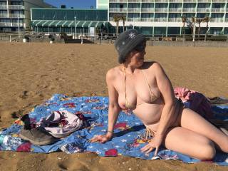 This was on Virginia Beach. It was a little chilly so there weren't many people out to see me in my new bikini. But one of man came along and was so sweet I let him take lots of pictures. I felt like a Porn Star !