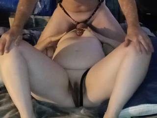 On her back for a Titty fuck