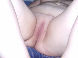 This is Jennys lovely shaven pussy. We would love to see you cum on her!