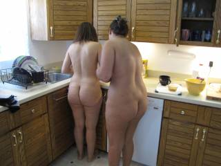 Sexy, my man would love for this to happen, shit even with clothes, Two women in the kitchen cooking. These two have some curvy and Sexy bodys!