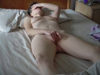 playing with her fresh shaved pussy