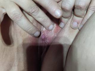 My wife playing with her clit