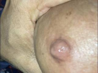 Trying to get my hand around her huge areola... fingers won't touch! All natural titties love to be fondled, sucked and jizzed on. Ya think she'll lick the cum off??
