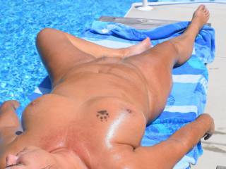 Getting horny laying here naked by the pool.