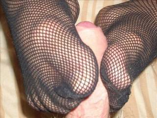 Love the way she's got her beautiful toes wrapped around this lucky dude's cock!!!