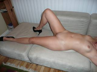 Perfect, nice smooth pussy, sure would like to give it a few swipes with my tongue, nice tits too.  I confess, I would like to play with you sexy.