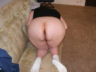 her bent over waiting for both holes to be filled