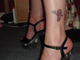 You have extremely sexy legs, in fact your picture is in the dictionary next to the word sexy. Love your ink, it is so fitting, your such a sex loving devil