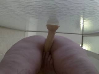 Kit playing in the shower, with a suction cup dildo and her vibe...