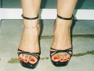 showing off her feet she likes to catch guys staring at her feet teasing with ankle braclets and toe rings on BOTH FEET