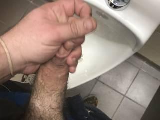 Jacking off in public restroom