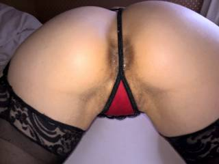Pull my panties to one side and press the head of your big cock up against my pussy so you can feeel just how wet I am