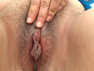 Her wet, hairy cunt and awesome, big clit