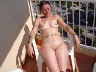 Another of the wife naked on the balcony, the guy in the next room saw her, he hung around for 20 minutes!