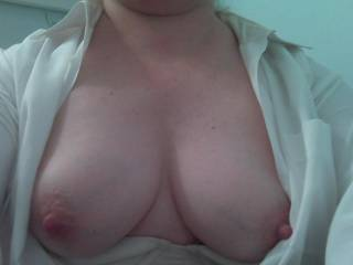 A slut wife showing me her full nipples as she changed to come visit me for a play date