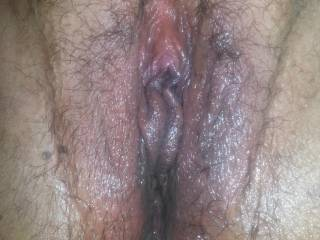 Up close pic of her wet juicy cunt, she just got done squirting everywhere, what would you do with her sweet pussy?