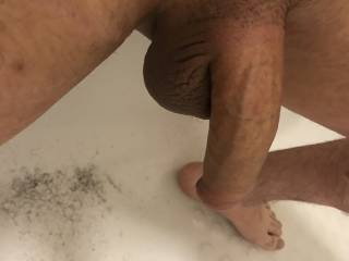 Freshly shaven my cock and balls, shaping my pubes around my cock and shaving my heavy balls bald. Who wants to help clean me up