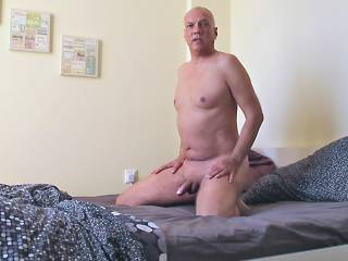 Porn actor Cane performing in a recent doggy style interracial fucking action with pornstar Olivia