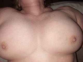 My wife's big beautiful tits covered with cum. 😛