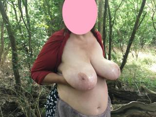 2 of 5 - standing on her right, a view as she holds her lovely tits up