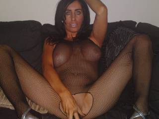show us dozens more of this sexy lady in this fishnet outfit!