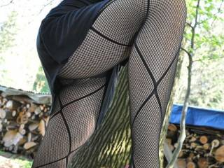 It's not the shoes that have grabbed my attention...what a beautiful ass all encased in fishnets...and upskirt too...I'm stroking my cock and dreaming...sure would love to get to know you two better X