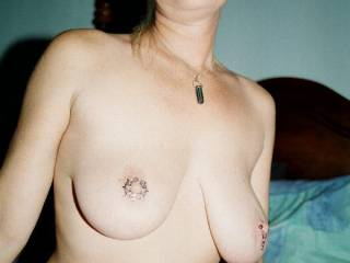 mmmm awesome tits babe, and love the nipple jewlery....