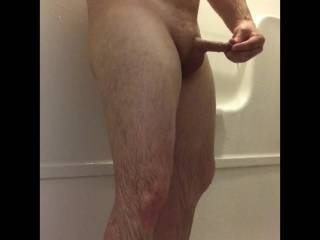Playing and goofing off in the shower.  I was on the road and feeling kinky so I turned my penis into my vagina..