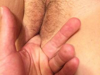 He's getting my pussy moist so he can put his hard cock in.do you want to see his cock in me?