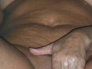Rubbing my wet oily pussy.