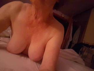 Busty mature Irene playing with her big tits for the camera