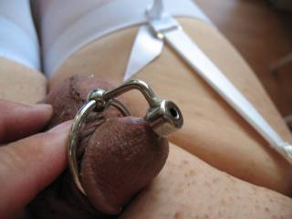 Have the white stockings on with white garter belt and he is wearing his jewelry.  Nice view.