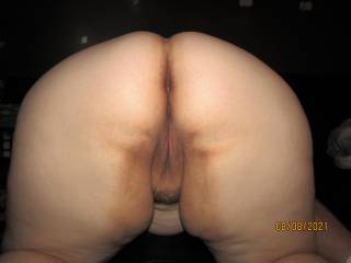 My lovely wife bent over showing off her wide hips and beautiful fat ass, ready to take some cock doggie style.