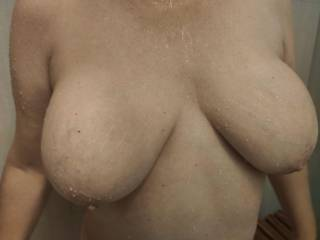 I am in the shower... Will you join me? Soap up my married tits and give me some of your loving.