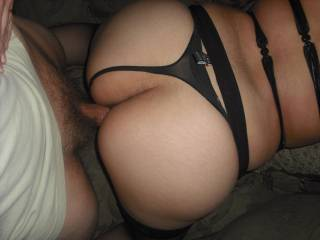 A nice, thick cock in a nice, round, beautifuk ass.  That looks like one great fuck for both of you.  Love the hot lingerie and how the thong is moved to the side, so he can fuck you.  Outstanding action shot.