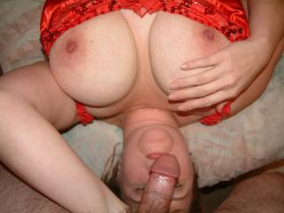 Wife playing with nipple while giving me head