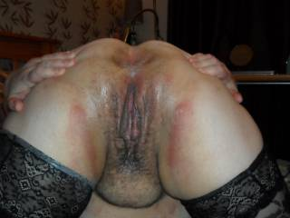 holding her lips open ready for cock