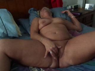 She loves playing with her pussy almost as much as I do and especially having all of you watch. Tell us how you like it and post those naughty comments. She loves reading them