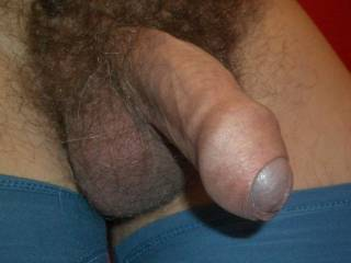 Wonderful, full uncut cock and beautiful foreskin and sac.
